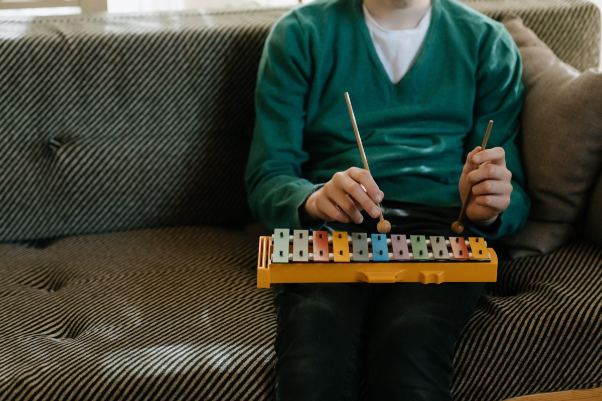 Person playing xylophone.
